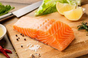 Salmon on cutting board