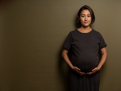 holding pregnant belly