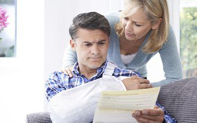 Injured man and woman looking at paperwork