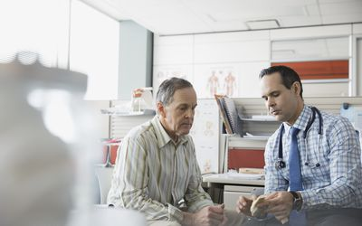Doctor and patient looking at anatomical model
