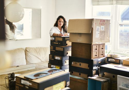 Woman packing boxes ahead of a move.