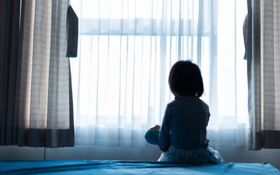 Child in darkened room to protect from xeroderma pigmentosum