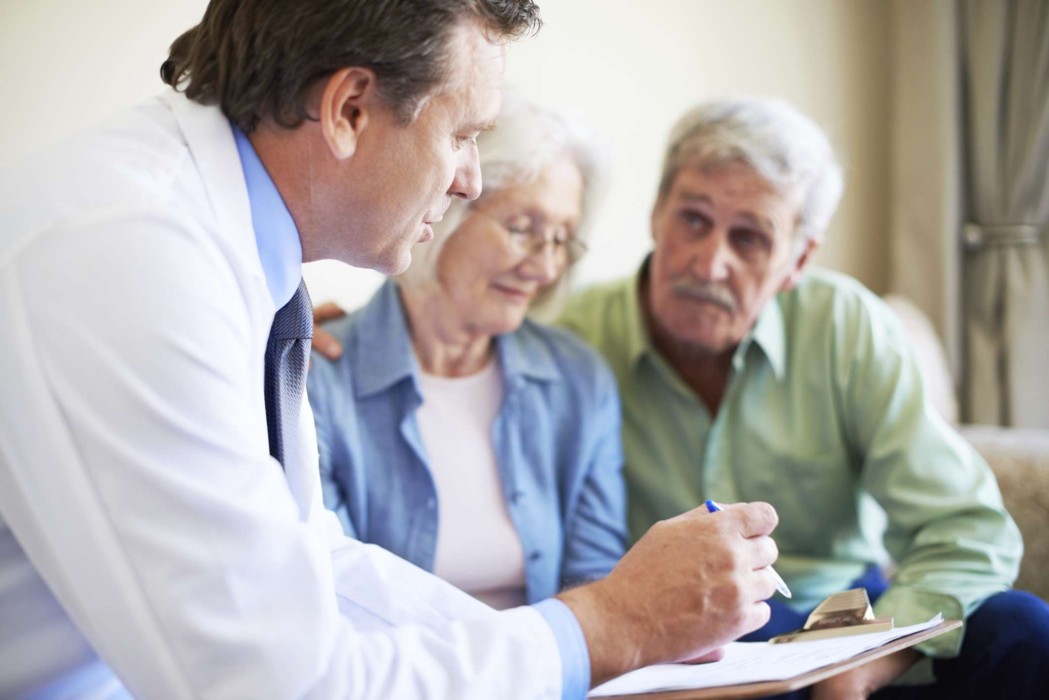 Older couple talking with a doctor