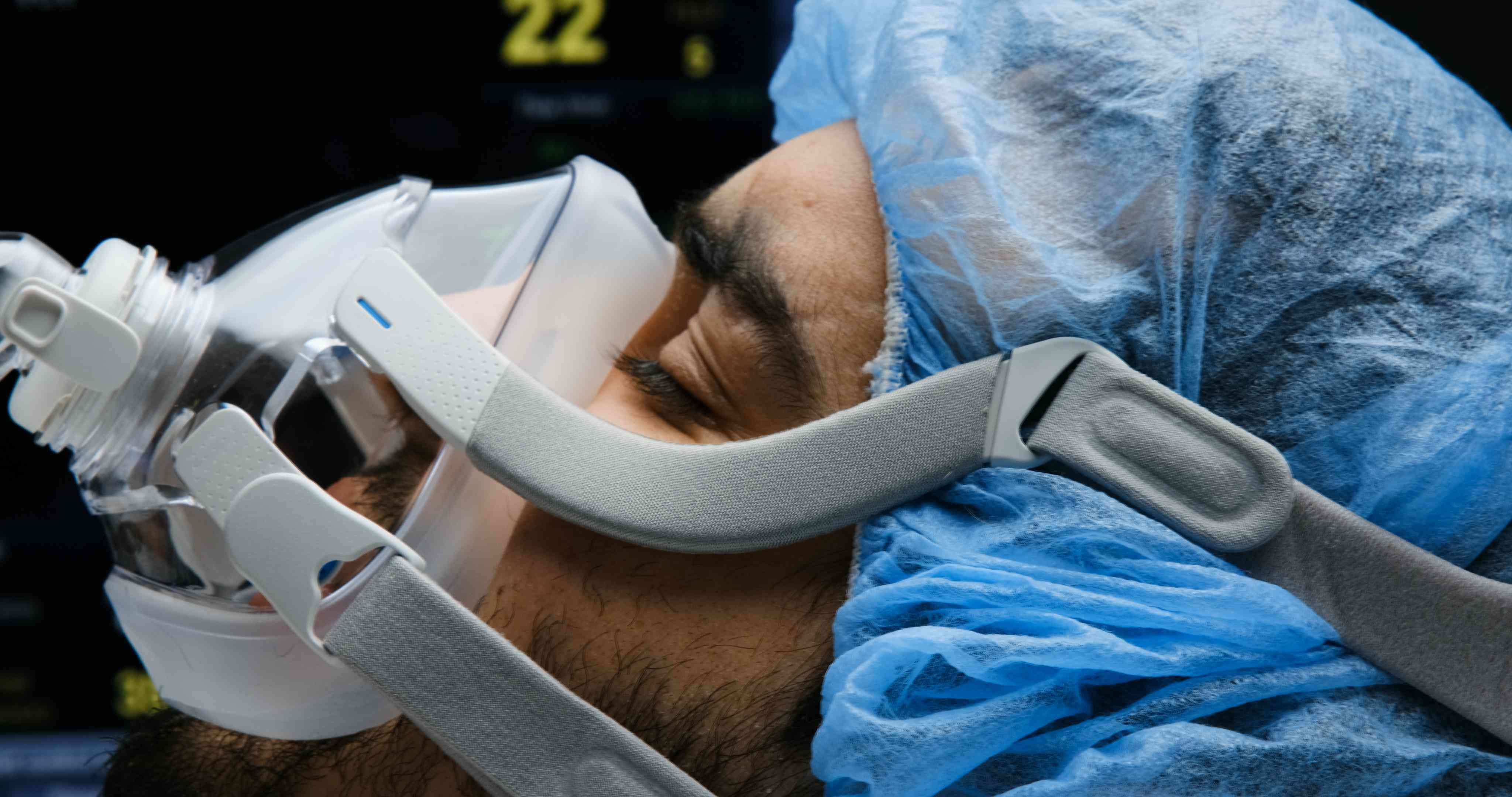 Young man connected to a ventilator mask