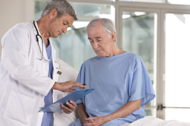 doctor with patient looking at a chart