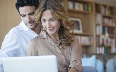 Couple looking at health plans