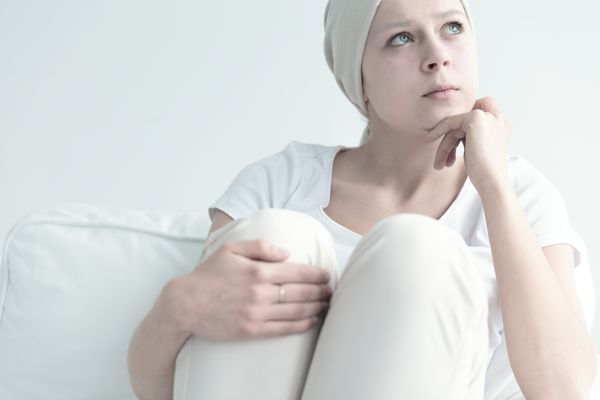 woman in cancer therapy contemplating decisions