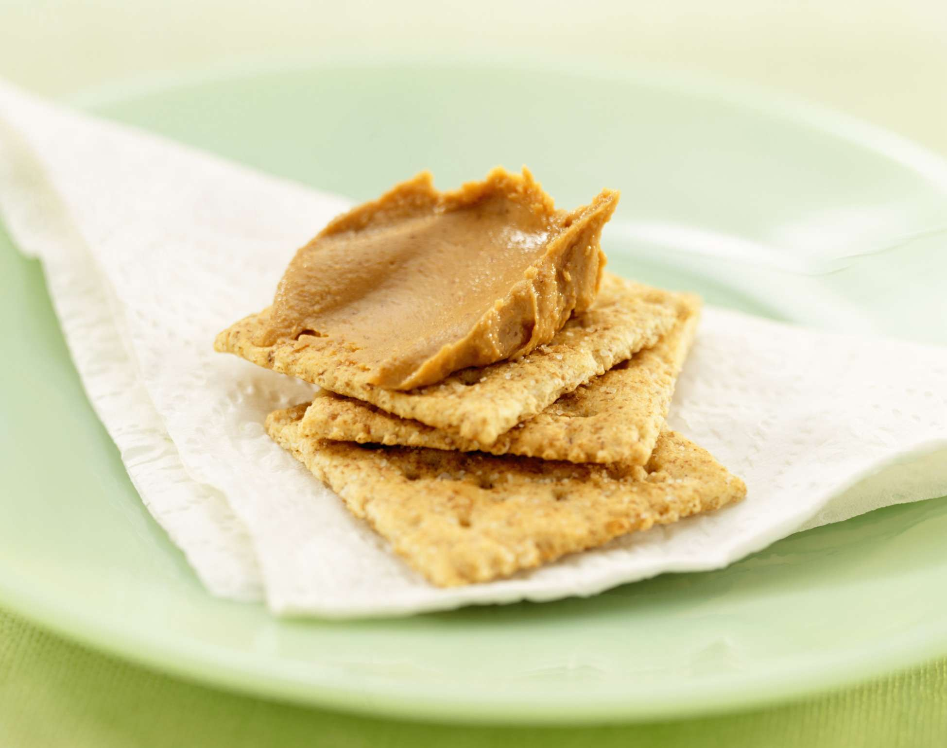Crackers with peanut butter on them