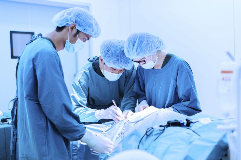 surgeons operating on a patient doing a pleurectomy for cancer