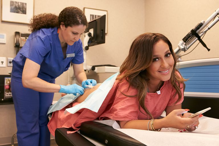 Adrienne Bailon all smiles after her tattoo removal
