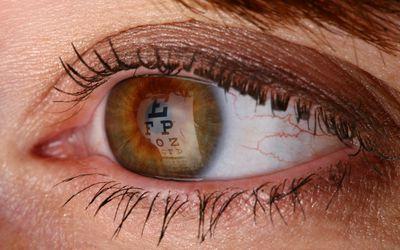 eye exam chart reflection in eye