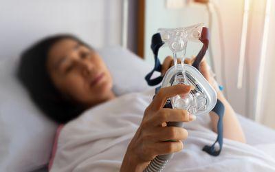 Woman using a CPAP machine.