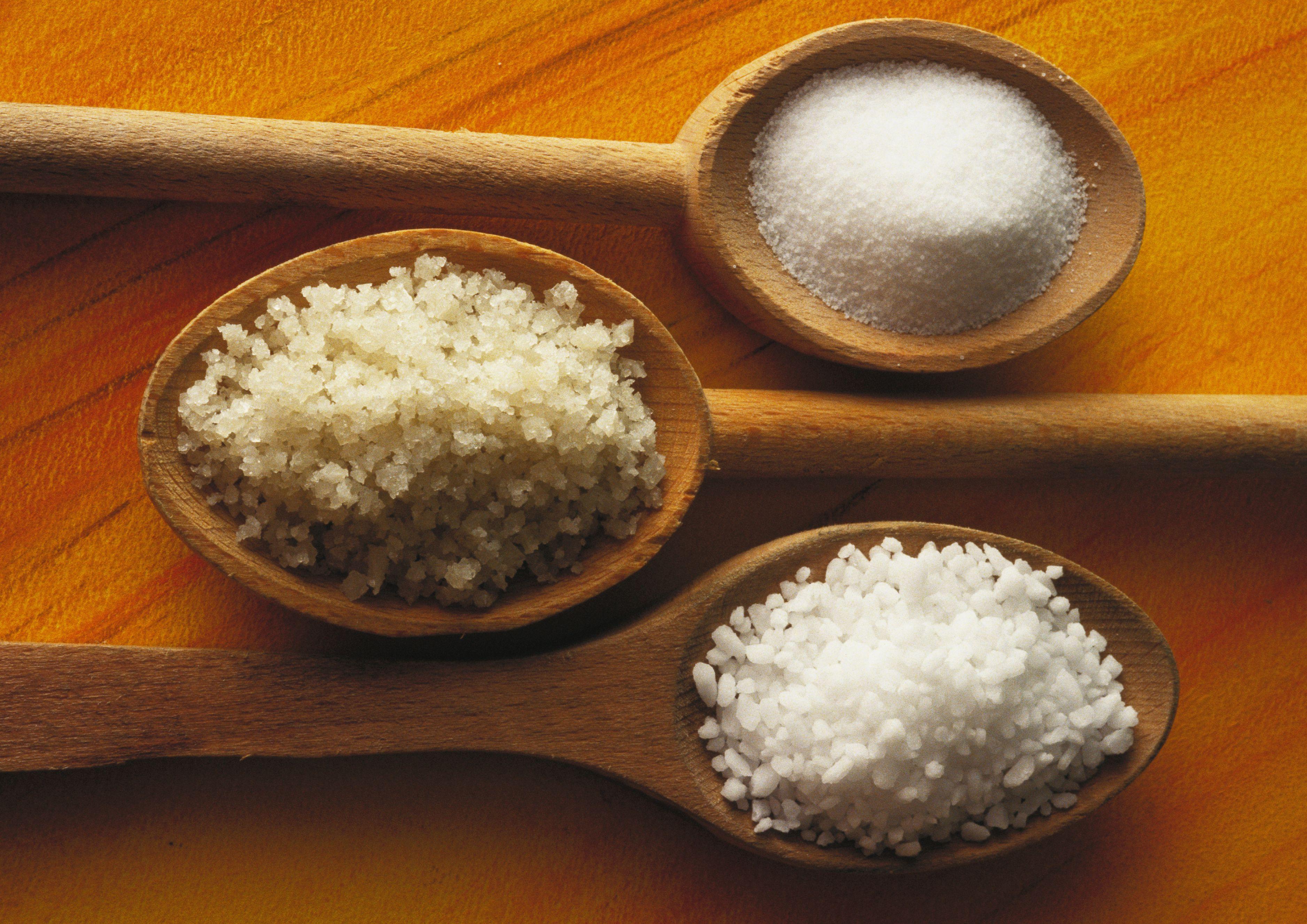 Three types of salt in wooden spoons