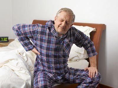 senior man with morning stiffness in back