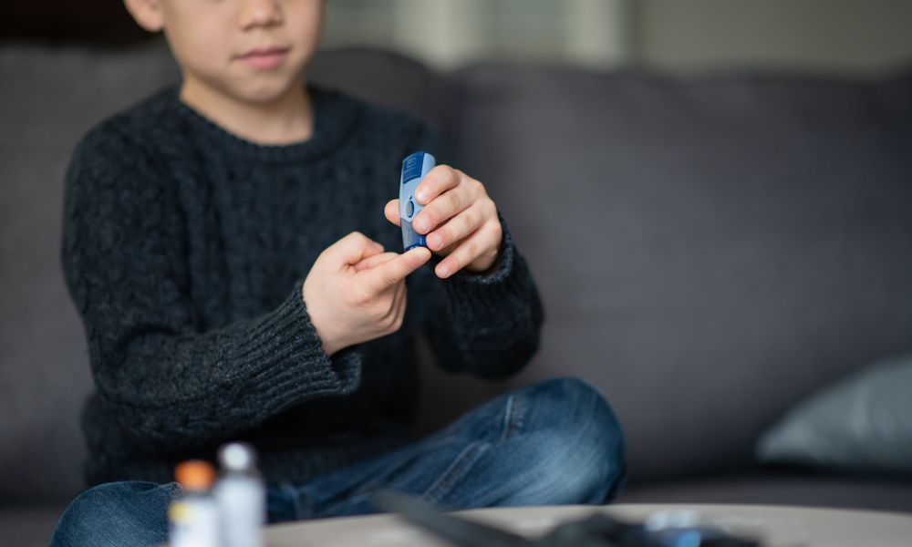 Boy checking his blood sugar