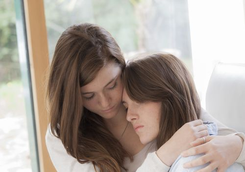 Sisters comforting each other.