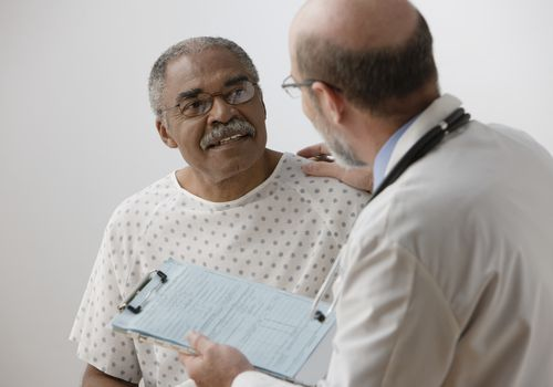 Senior man talking to male doctor