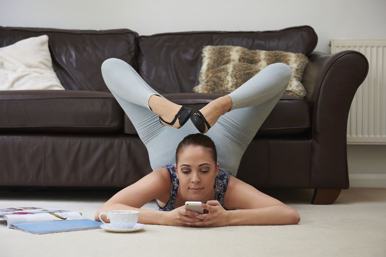 Contortionist using smartphone