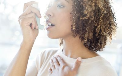 Adult woman using inhaler