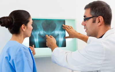 Radiologist discussing x-ray with a nurse