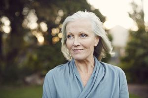 Portrait of older woman outdoors