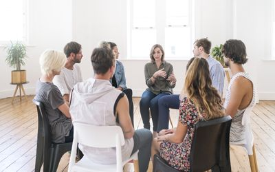 Support group gathering for a meeting