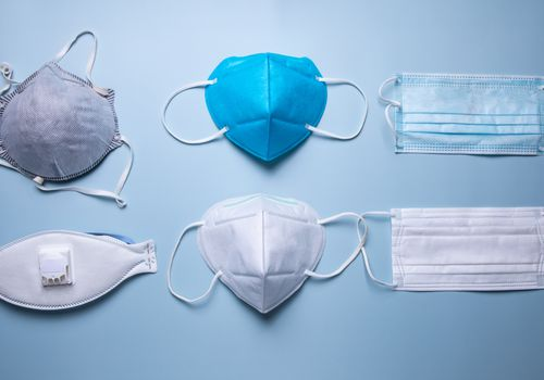 An array of face masks on a pale blue background.