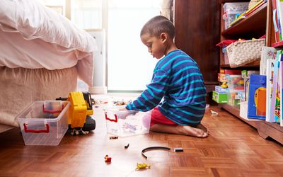 Child playing with toys in his room