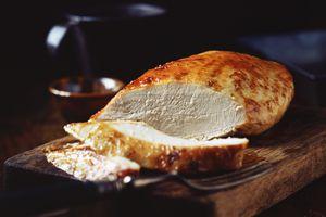 turkey breast on a cutting board