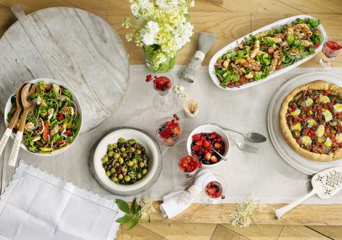 Selection of Mediterranean style dishes, overhead view on table