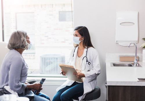 Doctor advising an older adult patient.