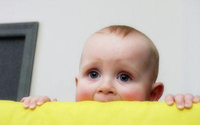 Baby peeking out of crib