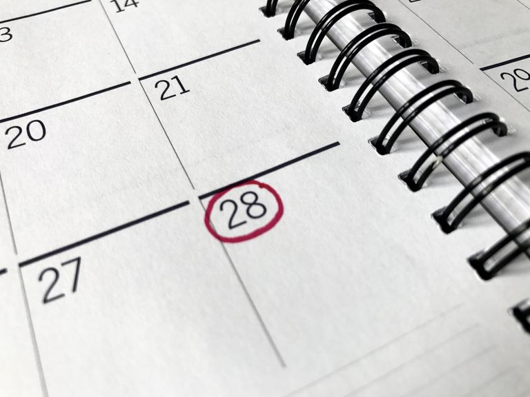 Close up of monthly calendar with date circled in red