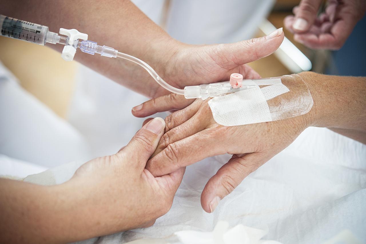 Nurse giving a patient morphine through an IV