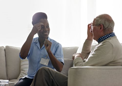 Therapist carrying out EFT treatment with elderly patient