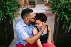 Man kissing woman on the head