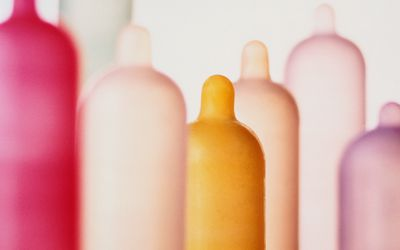 Different colored condoms on tubes