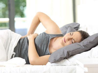Woman waking up suffering back ache