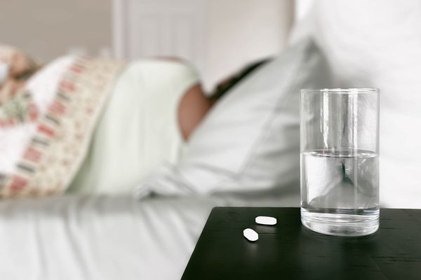 Ailing Woman Rests in Bed