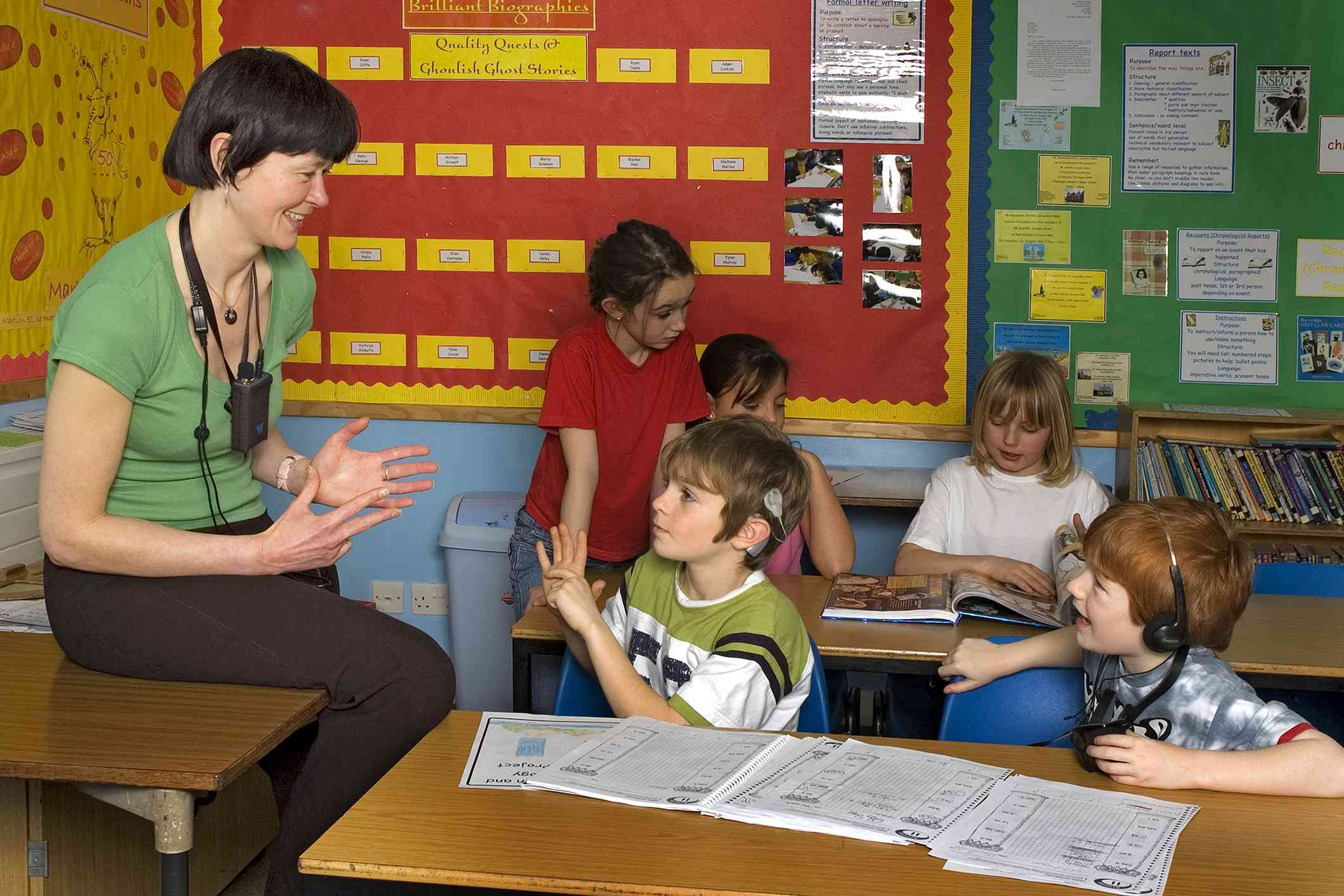 Teacher working with deaf students in a classroom