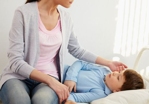 woman checking ill son