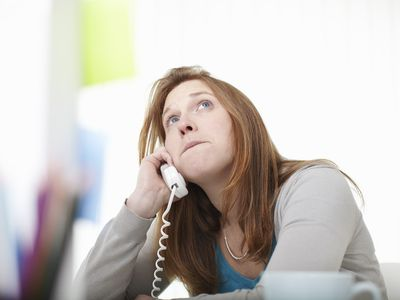 Girl on the telephone sitting at desk