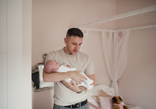 New dad holding infant.