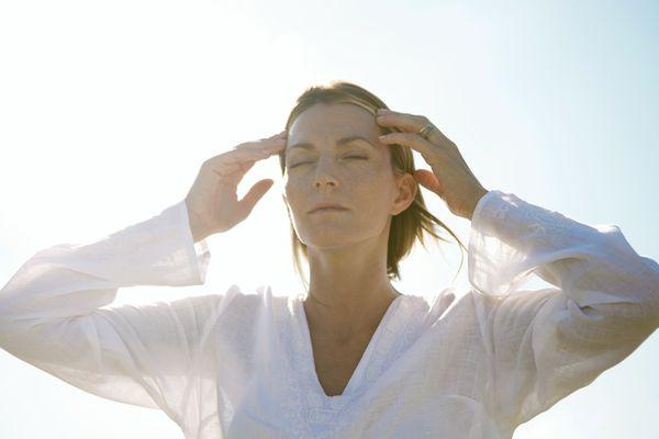 Woman holding head