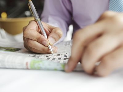 a person working on a crossword puzzle