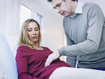 Doctor Examining Patients Abdomen