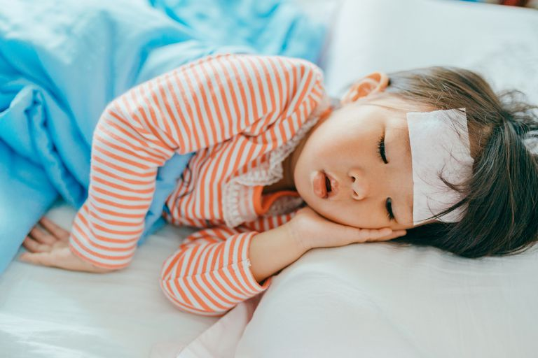 Child with fever sleeping