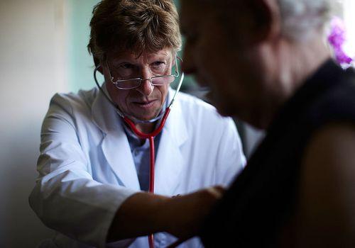 doctor evaluating patient