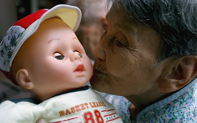 Woman with Dementia and Her Baby Doll