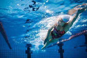 Underwater shot of fit swimmer training in the pool